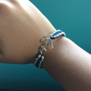 Navy blue and white bracelet with an anchor.